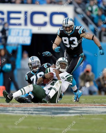 Geno Smith, Greg Hardy, Chase Blackburn. New York Jets' Geno Smith (7) hangs onto the football after being sacked by Greg Hardy (76) during the first half of an NFL football game in Charlotte, N.C., . Carolina Panthers' Chase Blackburn (93) runs in to celebrate. The Panthers won 30-20