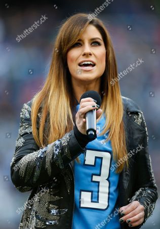 Lead singer Rachel Reinert from the award-winning and critically-acclaimed trio Gloriana performs the National Anthem before an NFL football game, in Nashville, Tenn