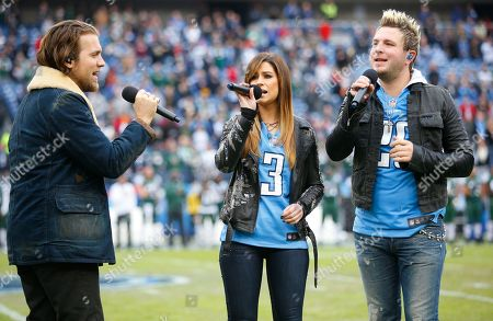 Stock Picture of Mike Gossin, Tom Gossin, Rachel Reinert. Tom Gossin, right, Rachel Reinert, center, and Mike Gossin, left, perform the National Anthem before an NFL football game, in Nashville, Tenn