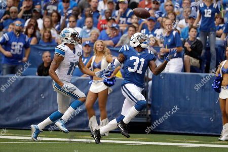 Antonio Cromartie, Marvin Jones. Indianapolis Colts defensive back Antonio Cromartie (31) looks to make an interception of a pass intended for Detroit Lions wide receiver Marvin Jones (11) during the first half of an NFL football game in Indianapolis