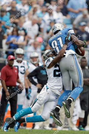 Antoine Cason, Calvin Johnson. Carolina Panthers' Antoine Cason (20) gets the hit on Detroit Lions' Calvin Johnson (81) during the first half of an NFL football game in Charlotte, N.C., . The Panthers won 24-7