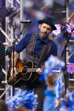 Musician Tony Lucca performs during the half-time period of an NFL football game between the Detroit Lions and the Green Bay Packers at Ford Field in Detroit