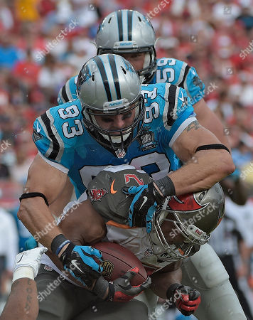 Carolina Panthers outside linebacker Chase Blackburn (93) stops Tampa Bay Buccaneers running back Doug Martin (22) during the second quarter of an NFL football game, in Tampa, Fla