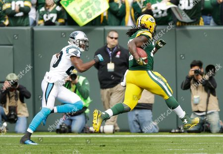 Antoine Cason, Eddie Lacy. Green Bay Packers' Eddie Lacy gets past Carolina Panthers' Antoine Cason for a touchdown run during the first half of an NFL football game, in Green Bay, Wis
