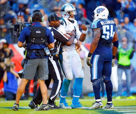 Cam Newton, Avery Williamson. Carolina Panthers quarterback Cam Newton (1) does his touchdown celebration in front of Tennessee Titans inside linebacker Avery Williamson (54) during an NFL football game, in Nashville, Tenn. The Panthers won 27-10