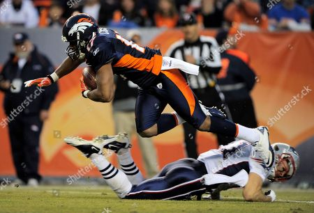 Denver Broncos wide receiver Quan Cosby is tripped up by the New England Patriots during an NFL football game, in Denver