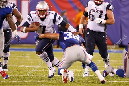 New England Patriots quarterback Jacoby Brissett (7) is tackled by New York Giants' Justin Currie (36) during the second half of a preseason NFL football game, in East Rutherford, N.J
