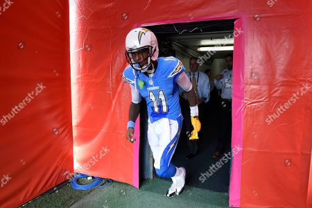 San Diego Chargers wide receiver Stevie Johnson walks onto the field before an NFL football game against the Oakland Raiders, in San Diego