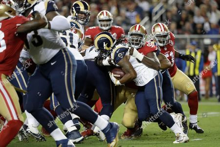 Quinton Dial, Todd Gurley. San Francisco 49ers defensive end Quinton Dial (92) tackles Los Angeles Rams running back Todd Gurley during the first half of an NFL football game in Santa Clara, Calif