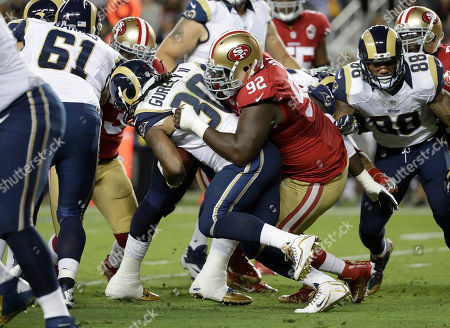 Quinton Dial, Todd Gurley. San Francisco 49ers defensive end Quinton Dial (92) tackles Los Angeles Rams running back Todd Gurley (30) during an NFL football game in Santa Clara, Calif