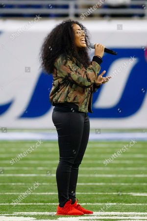 Malaya Watson from American Idol performs the national anthem prior to an NFL football game between the Detroit Lions and the Los Angeles Rams, in Detroit