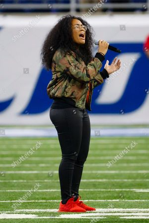 Stock Image of Malaya Watson from American Idol performs the national anthem prior to an NFL football game between the Detroit Lions and the Los Angeles Rams, in Detroit
