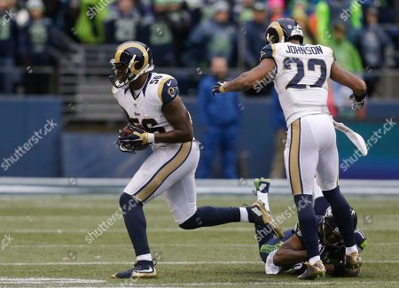 Akeem Ayers, Kevin Smith, Trumaine Johnson. St. Louis Rams' Akeem Ayers (56) runs with the ball as he heads to score a touchdown on a fumble recovery, followed by Trumaine Johnson (22) and Seattle Seahawks' Kevin Smith in the first half of an NFL football game, in Seattle