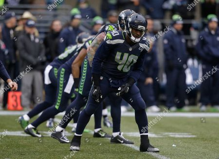 Seattle Seahawks' Derrick Coleman and teammates line-up for the opening kick against the St. Louis Rams to start the first half of an NFL football game, in Seattle