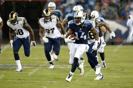 Tennessee Titans wide receiver Hakeem Nicks (14) runs the ball against the St. Louis Rams in the first half of a preseason NFL football game, in Nashville, Tenn