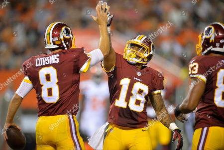Kirk Cousins, Reggie Bell. Washington Redskins quarterback Kirk Cousins (8) celebrates his rushing touchdown with wide receiver Reggie Bell (18) during an NFL preseason football game against the Cleveland Browns, in Cleveland. Washington won 20-17