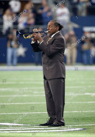 Entertainer Freddie Jones plays the national anthem during an NFL football game between the Washington Redskins and Dallas Cowboys, in Arlington, Texas