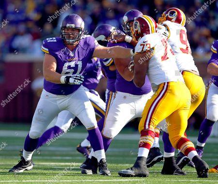 Minnesota Vikings guard Joe Berger (61) blocks against the Washington Redskins during an NFL football game, in Minneapolis