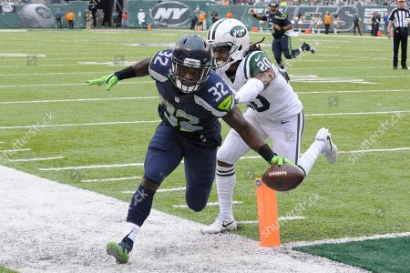 Stock Image of Christine Michael, Marcus Williams. Seattle Seahawks running back Christine Michael (32) scores a touchdown as Seattle Seahawks cornerback Jeremy Lane (20) attempts to force him out of bounds during the second half of an NFL football game, in East Rutherford, N.J