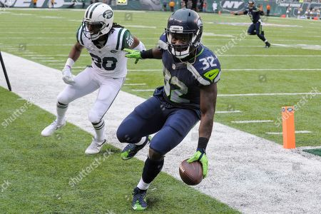 Christine Michael, Marcus Williams. Seattle Seahawks running back Christine Michael (32) scores a touchdown as Seattle Seahawks cornerback Jeremy Lane (20) attempts to force him out of bounds during the second half of an NFL football game, in East Rutherford, N.J