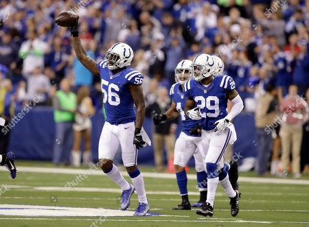 Indianapolis Colts linebacker Akeem Ayers (56) celebrates after intercepting a pass during the first half of an NFL football game against the Houston Texans, in Indianapolis