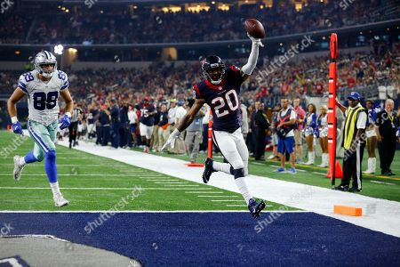 Houston Texans defensive back Antonio Allen (20) celebrates as he scores after intercepting a pass from Dallas Cowboys' Jameill Showers late in the second half of a preseason NFL football game, in Arlington, Texas. The Cowboys' Gavin Escobar (89) gives chase on the play