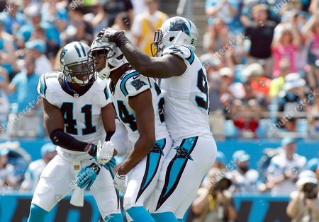 Roman Harper, Josh Norman, Mario Addison. Carolina Panthers' Roman Harper (41) celebrates with teammates Josh Norman (24) and Mario Addison (97) after a play against the Houston Texans during the first half of an NFL football game in Charlotte, N.C., . The Panthers won 24-17