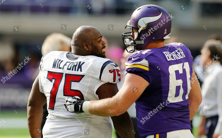 Vince Wilfork, Joe Berger. Houston Texans nose tackle Vince Wilfork, left, talks with Minnesota Vikings center Joe Berger, right, after an NFL football game, in Minneapolis. The Vikings won 31-13
