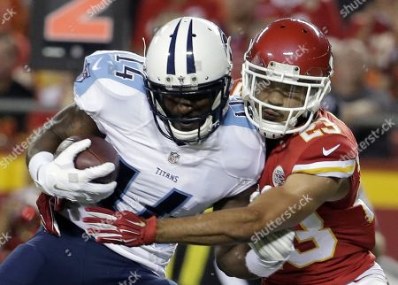 Hakeem Nicks, Phillip Gaines. Tennessee Titans wide receiver Hakeem Nicks (14) is tackled by Kansas City Chiefs defensive back Phillip Gaines (23) during the first half of a preseason NFL football game at Arrowhead Stadium in Kansas City, Mo
