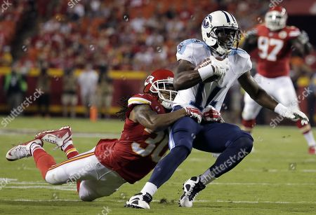 Jamell Fleming, Hakeem Nicks. Tennessee Titans wide receiver Hakeem Nicks (14) is tackled by Kansas City Chiefs defensive back Jamell Fleming (30) during the first half of a preseason NFL football game at Arrowhead Stadium in Kansas City, Mo