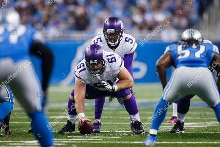 Joe Berger, Teddy Bridgewater. Minnesota Vikings quarterback Teddy Bridgewater (5) prepares to take the snap from center Joe Berger (61) during the first half of an NFL football game against the Detroit Lions, in Detroit