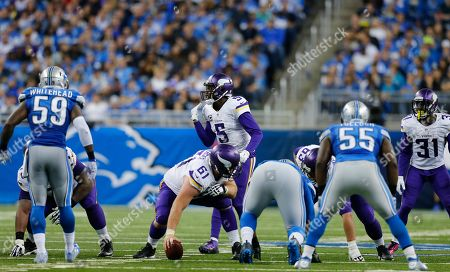 Teddy Bridgewater, Joe Berger. Minnesota Vikings quarterback Teddy Bridgewater (5) prepares to take the snap from center Joe Berger (61) during the second half of an NFL football game against the Detroit Lions, in Detroit