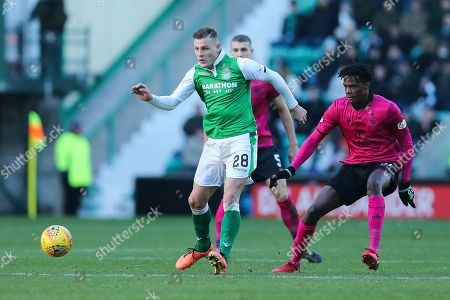 Anthony Stokes (#28) of Hibernian plays a short pass during the Ladbrokes Scottish Premiership match between Hibernian and Celtic at Easter Road, Edinburgh