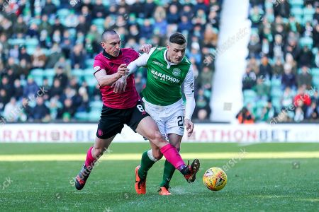 Scott Brown (#8) of Celtic challenges Anthony Stokes (#28) of Hibernian for the ball during the Ladbrokes Scottish Premiership match between Hibernian and Celtic at Easter Road, Edinburgh