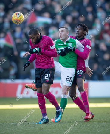 Anthony Stokes of Hibernian controls the ball between Olivier Ntcham & Dedryck Boyata of Celtic
