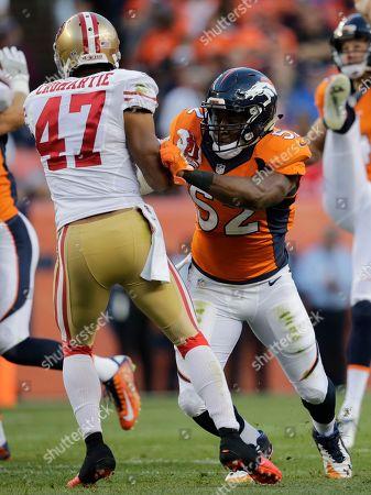 Denver Broncos outside linebacker Corey Nelson (52) blocks San Francisco 49ers cornerback Marcus Cromartie during the first half of a preseason NFL football game, in Denver