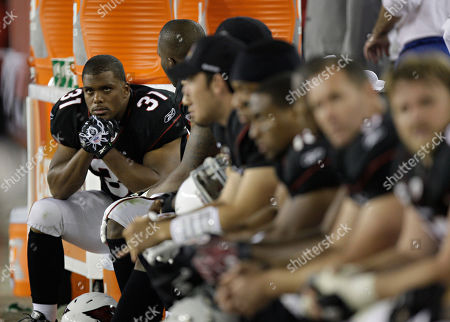 Arizona Cardinals running back Jason Wright (31) sits on the bench against the San Francisco 49ers during the fourth quarter of an NFL football game, in Glendale, Ariz. The 49ers won 27-6