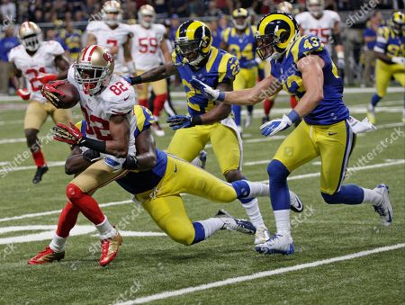 San Francisco 49ers wide receiver Mario Manningham (82) is brought down by St. Louis Rams during the second half of an NFL football game, in St. Louis. The Rams won 16-13 in overtime