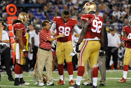 San Francisco 49ers defensive end Lawrence Okoye (98) is assisted off the field after a play in the second half of an NFL preseason football game against the Baltimore Ravens, in Baltimore