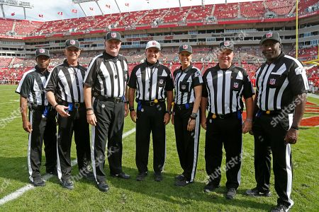 Dale Shaw, Rob Vernatchi, Ed Camp, Peter Morelli, Sarah Thomas, Steve Zimmer, Ruben Fowler. NFL officials, from left, back judge Dale Shaw, side judge Rob Vernatchi, head linesman Ed Camp, referee Peter Morelli, line judge Sarah Thomas field judge Steve Zimmer and umpire Ruben Fowler pose for a photograph before the start of an NFL football game between the Tampa Bay Buccaneers and the Chicago Bears, in Tampa, Fla