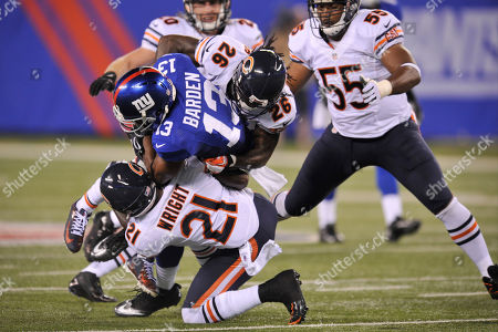 Ramses Bardenm, Major Wright, Tim Jennings. New York Giants wide receiver Ramses Barden (13) is tackled by Chicago Bears defensive back Major Wright (21) and Tim Jennings (26) during the first half of an NFL preseason football game, in East Rutherford, N.J