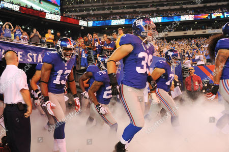 New York Giants wide receiver Ramses Barden (13) and Tyler Sash (39) walk on the field with teammates during the first half of an NFL preseason football game, in East Rutherford, N.J