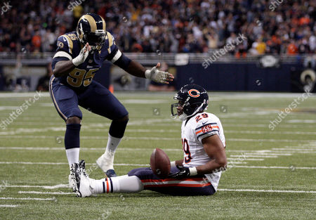 William Hayes, Michael Bush. St. Louis Rams defensive end William Hayes, top, applauds in celebration after Chicago Bears running back Michael Bush was stopped short of the end zone after being brought down for a 4-yard loss on fourth down during the third quarter of an NFL football game, in St. Louis