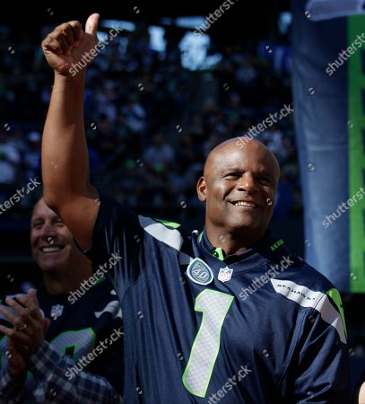 Former Seattle Seahawks quarterback Warren Moon is recognized during a halftime celebration of the 40th anniversary of the Seattle Seahawks Chicago Bears during an NFL football game against the Chicago Bears, in Seattle