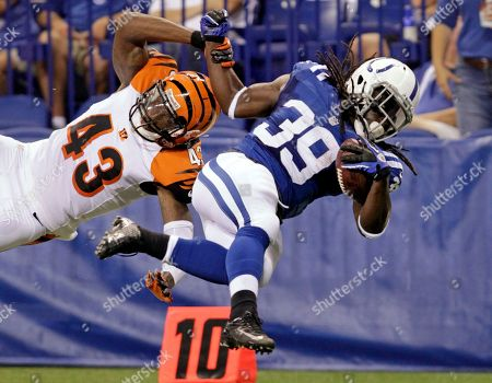 Deji Karim, George Iloka. Indianapolis Colts running back Deji Karim (39) is tackled from behind by Cincinnati Bengals free safety George Iloka in the first half of an NFL preseason football game in Indianapolis