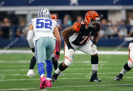 Stock Picture of Cedric Ogbuehi, Andrew Gachkar. Dallas Cowboys outside linebacker Andrew Gachkar (52) and Cincinnati Bengals offensive tackle Cedric Ogbuehi (70) line up against each other during an NFL football game, in Arlington