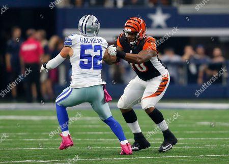 Cedric Ogbuehi, Andrew Gachkar. Dallas Cowboys outside linebacker Andrew Gachkar (52) rushes against Cincinnati Bengals offensive tackle Cedric Ogbuehi (70) during an NFL football game, in Arlington