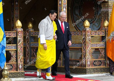 In this Handout photograph released by Bhutan Royal office for media shows Bhutan King Jigme Khesar Namgyel Wangchuck and Stockholm King Carl Gustaf come out from Tashichho Dzong in Thimphu, Bhutan