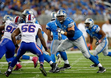 Riley Reiff, Keith Rivers. Detroit Lions tackle Riley Reiff (71) gets ready to block Buffalo Bills outside linebacker Keith Rivers (56) during an NFL game at Ford Field in Detroit on