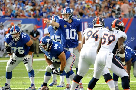 Stock Image of New York Giants quarterback Eli Manning (10) calls out the defense as Chris Snee (76) and David Baas (64) listen during the first half of an NFL football game against the Denver Broncos, in East Rutherford, N.J